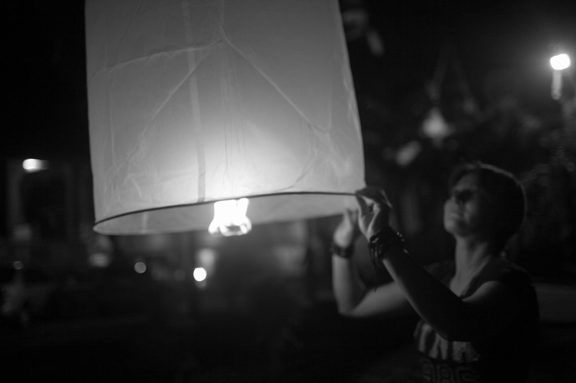 Lighting paper lanterns in Chiang Mai, Thailand.