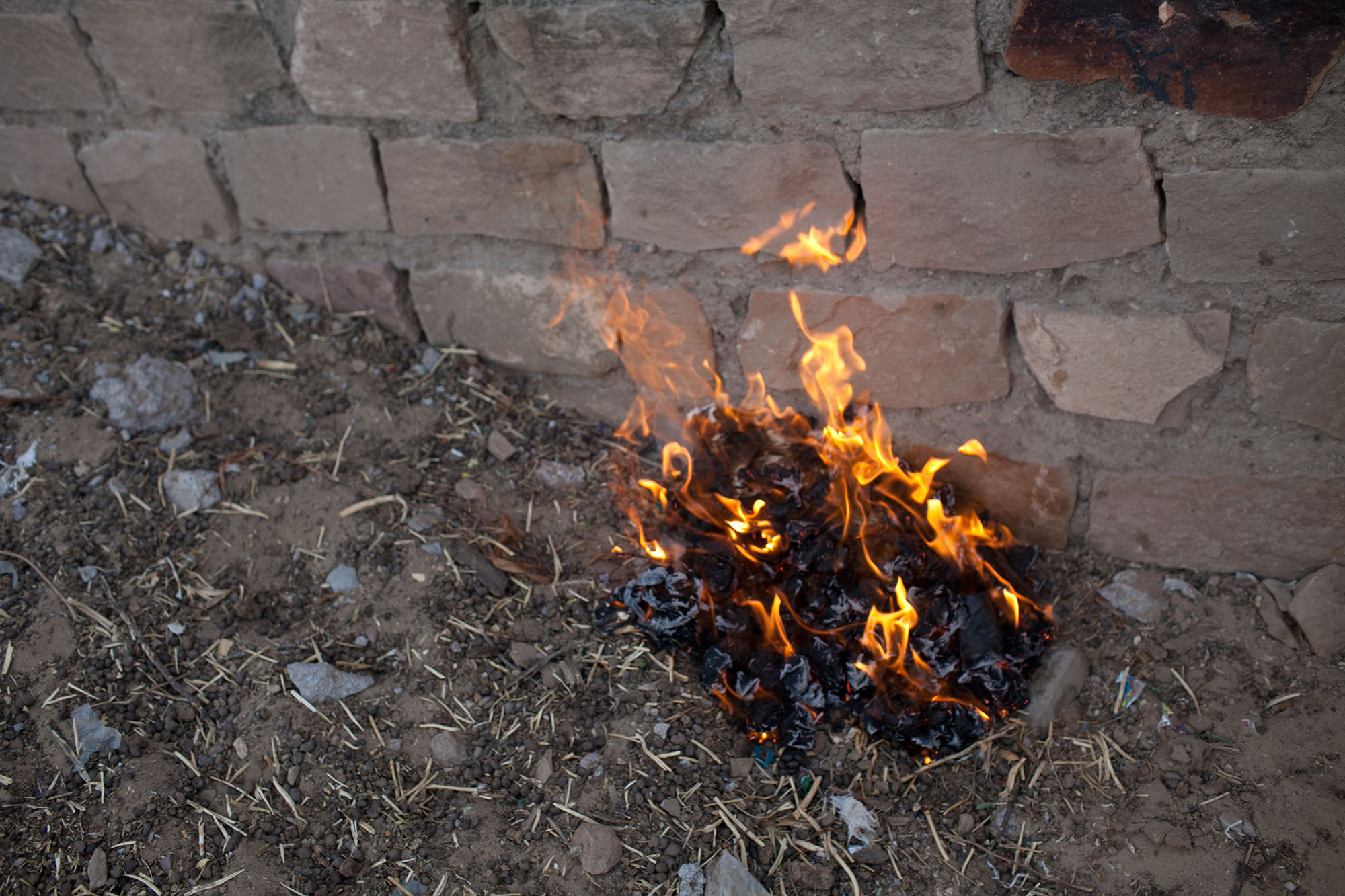 Burning two weeks of used toilet paper in Setrawa, India.