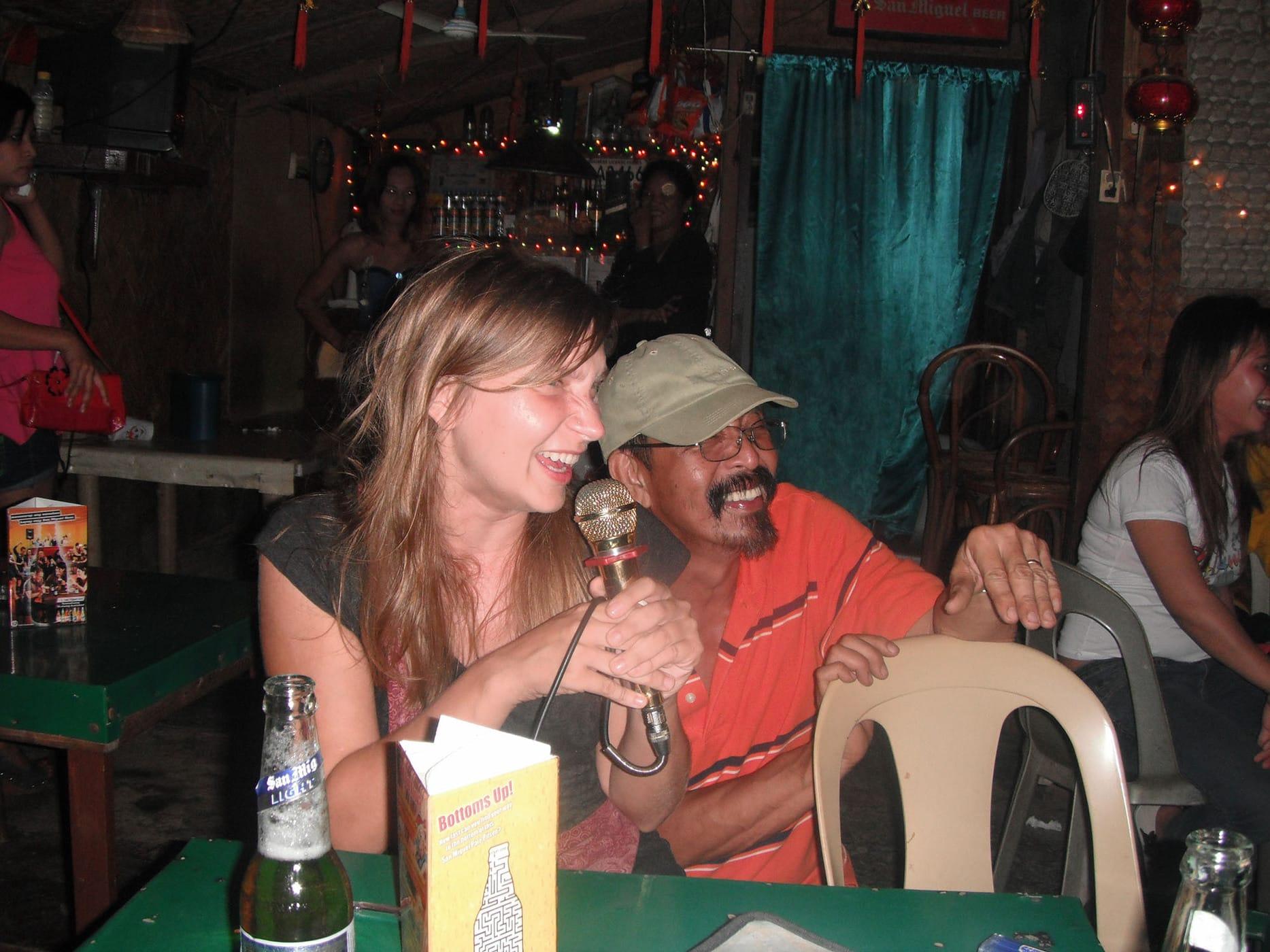 Singing karaoke in Puerto Princesa, Philippines.