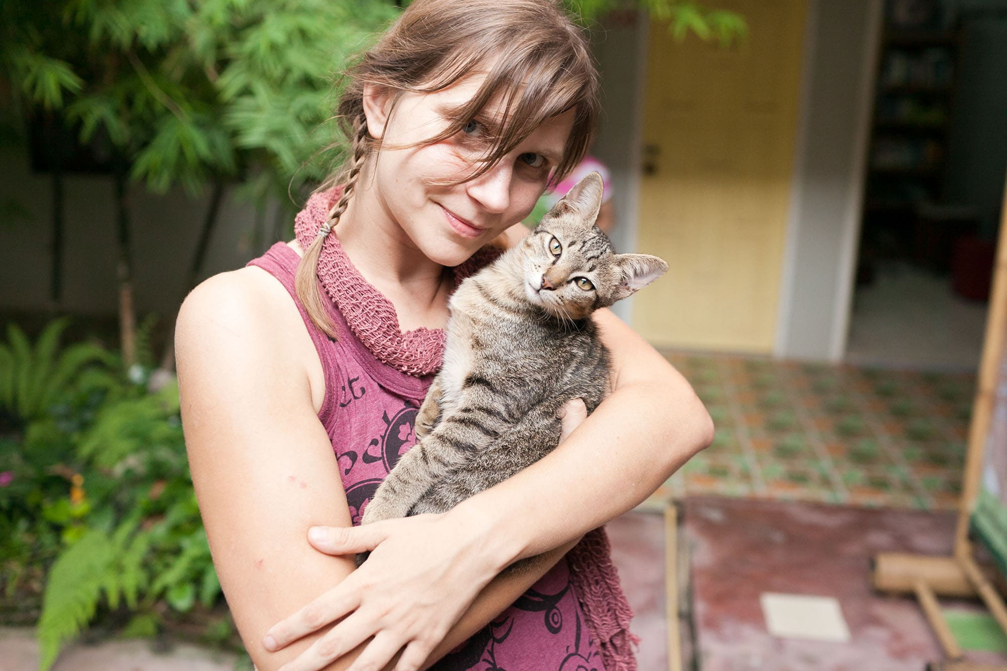 Val and her cat at Deejai Backpackers in Chiang Mai, Thailand