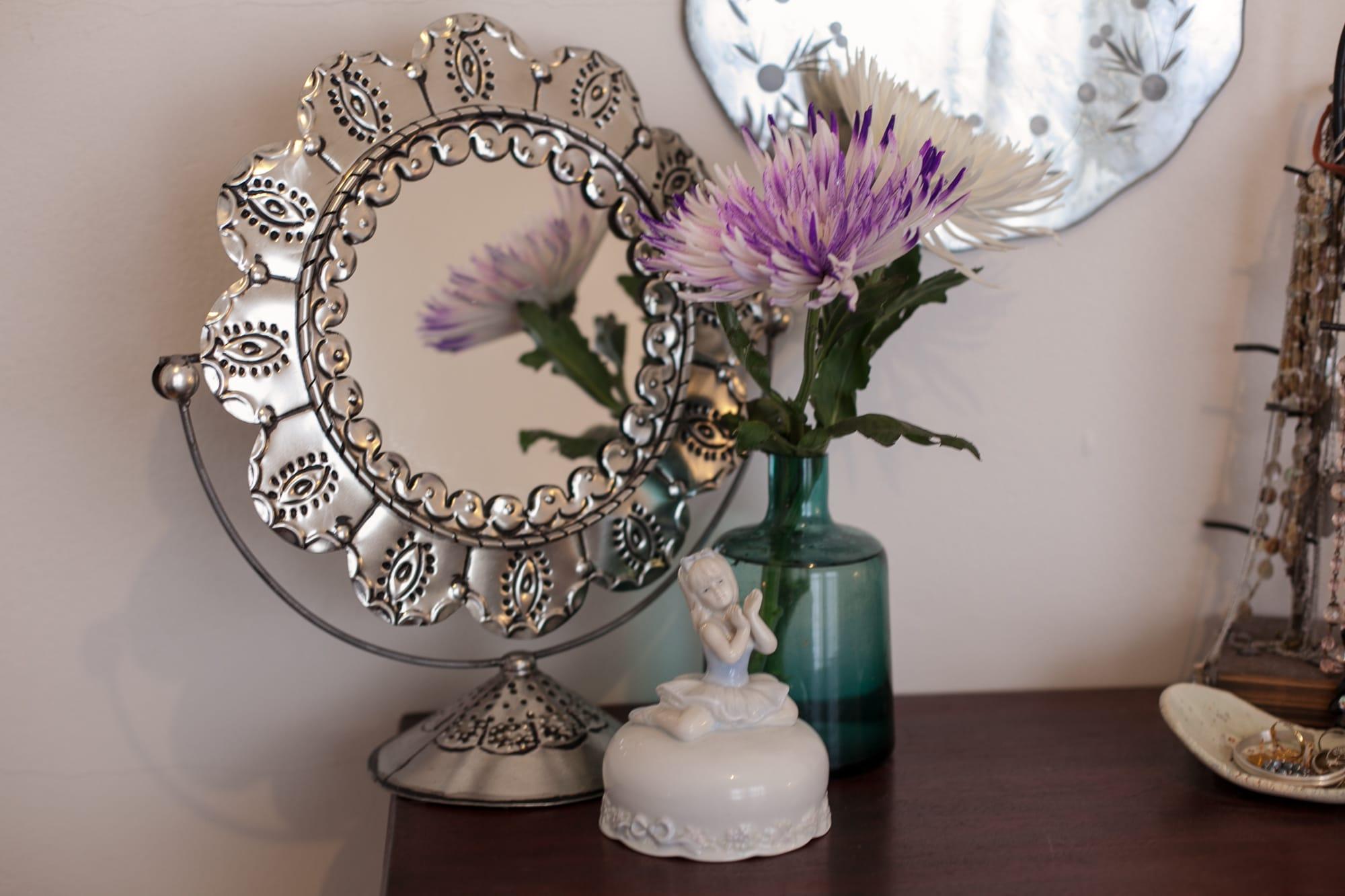 On my dresser: a mirror, a vase, and a ballerina music box.