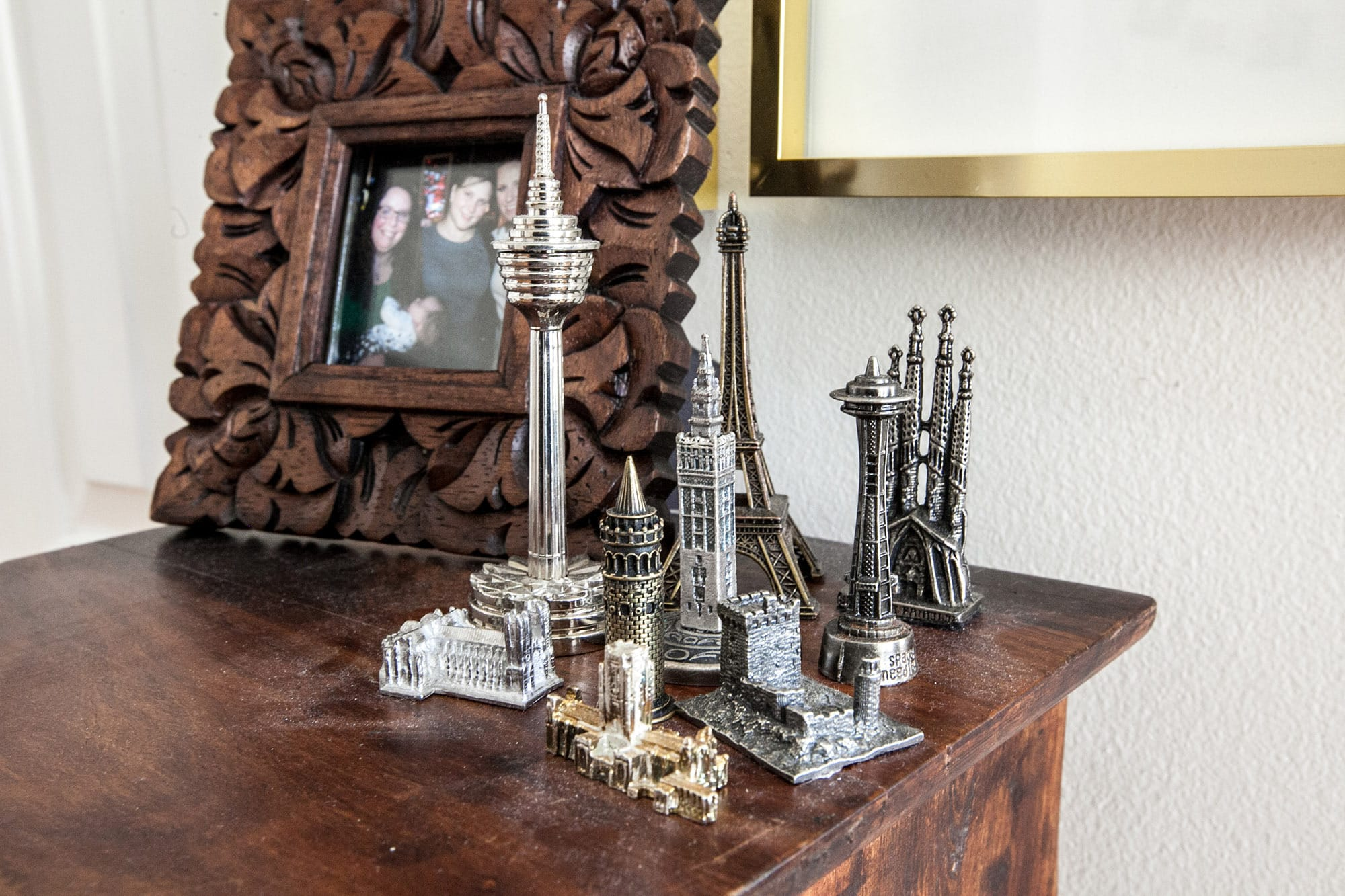 Miniature metal souvenir buildings from around the world.