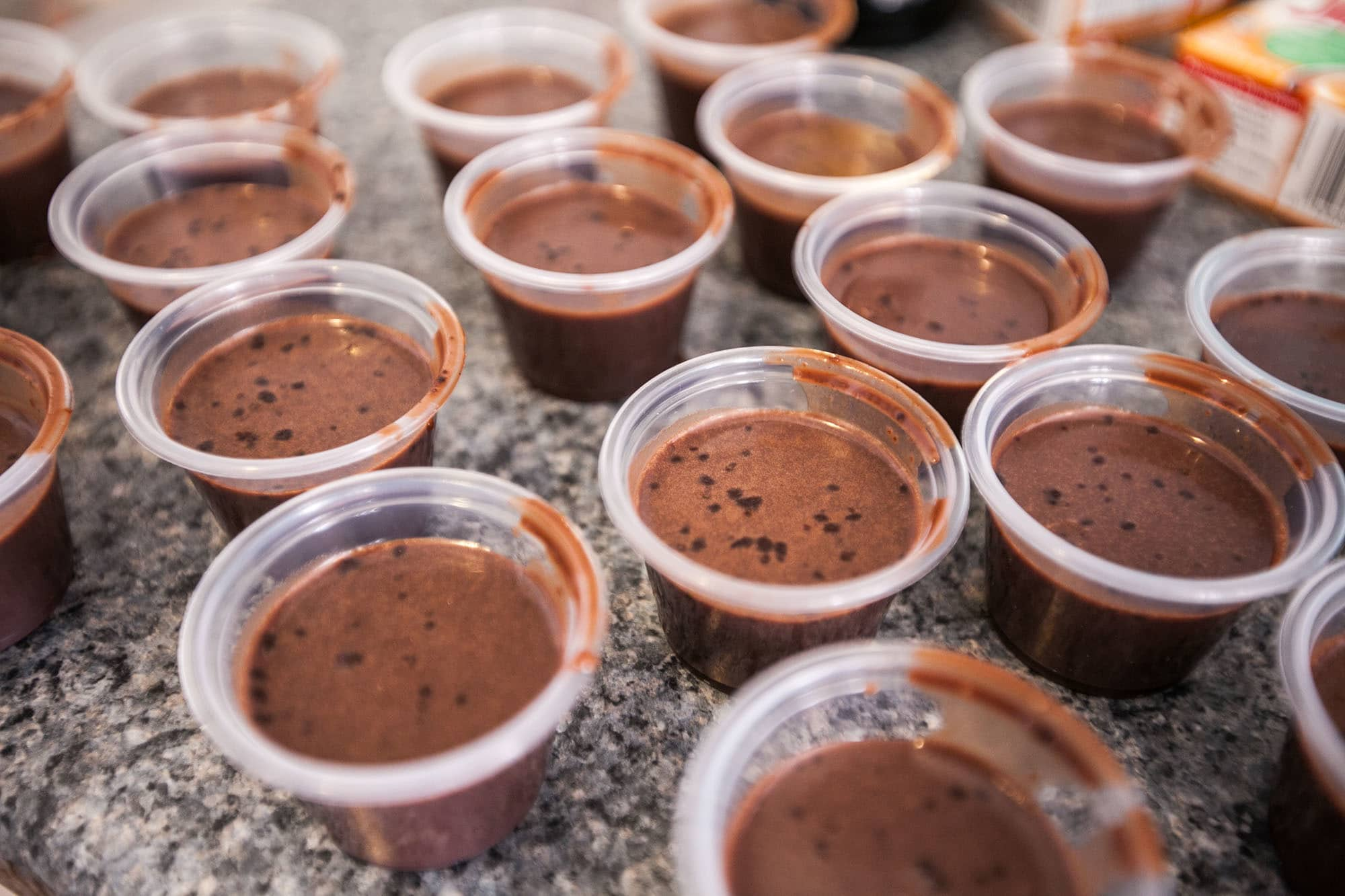 Mudslide pudding shot recipe with chocolate pudding, Baileys Irish Cream, and Kahlúa.