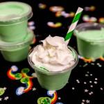 St. Patrick's Day Pudding Shots - frozen mint and vanilla cream pudding shots with crème de menthe, vanilla vodka, vanilla pudding, and cool whip