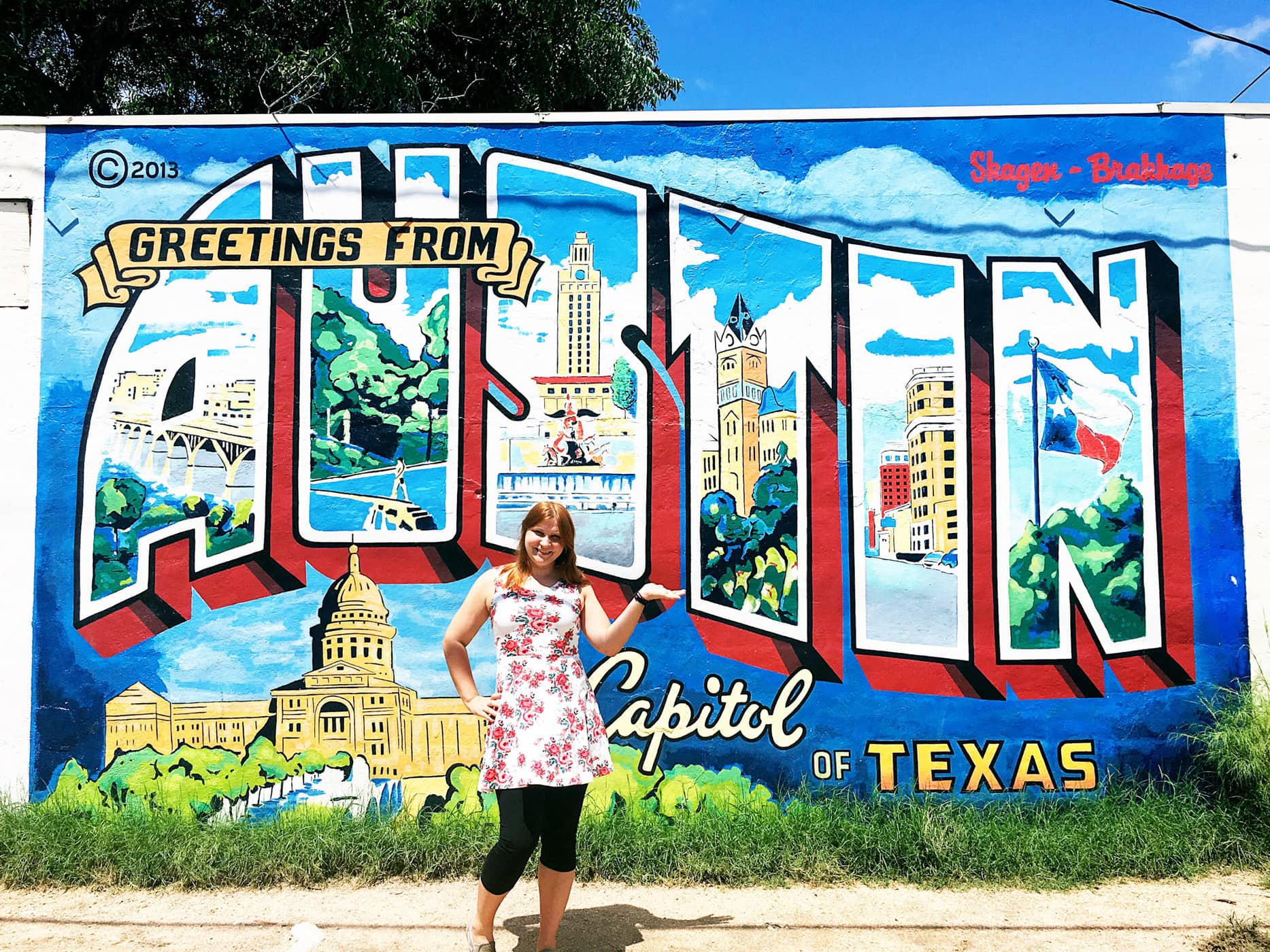 Me at the Greetings from Austin Mural in Austin, Texas.