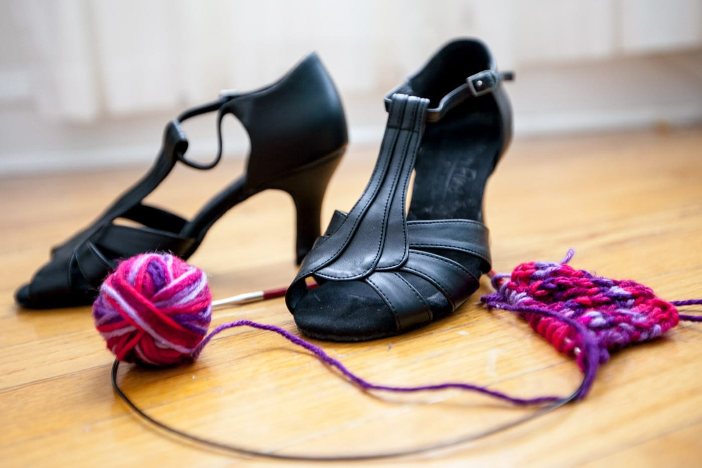 Salsa shoes and knitting needles.
