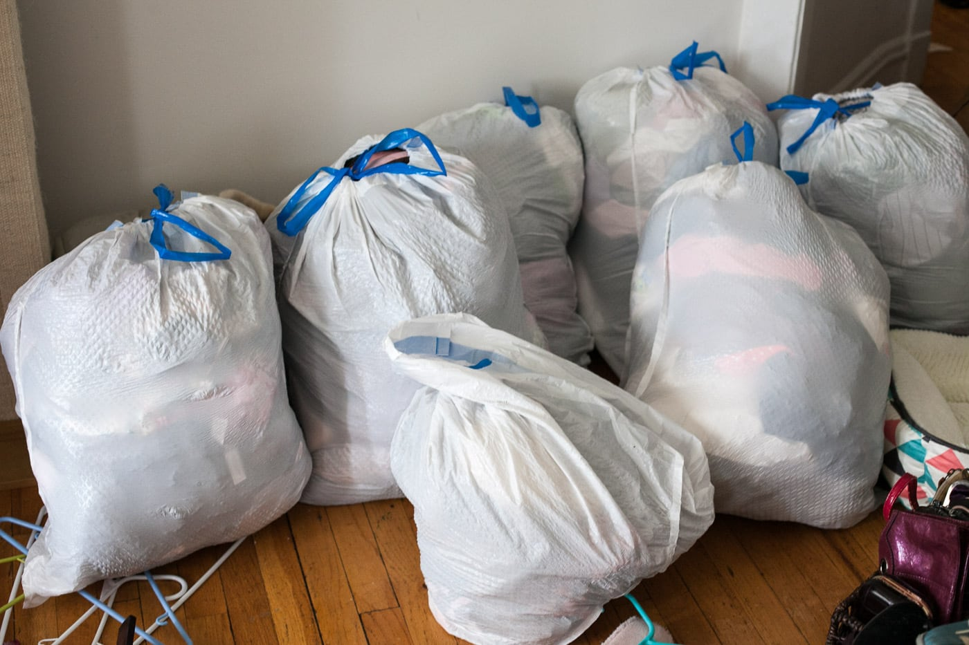 Bags and bags of clothes to get rid of after sorting through my clothes using the KonMari method.