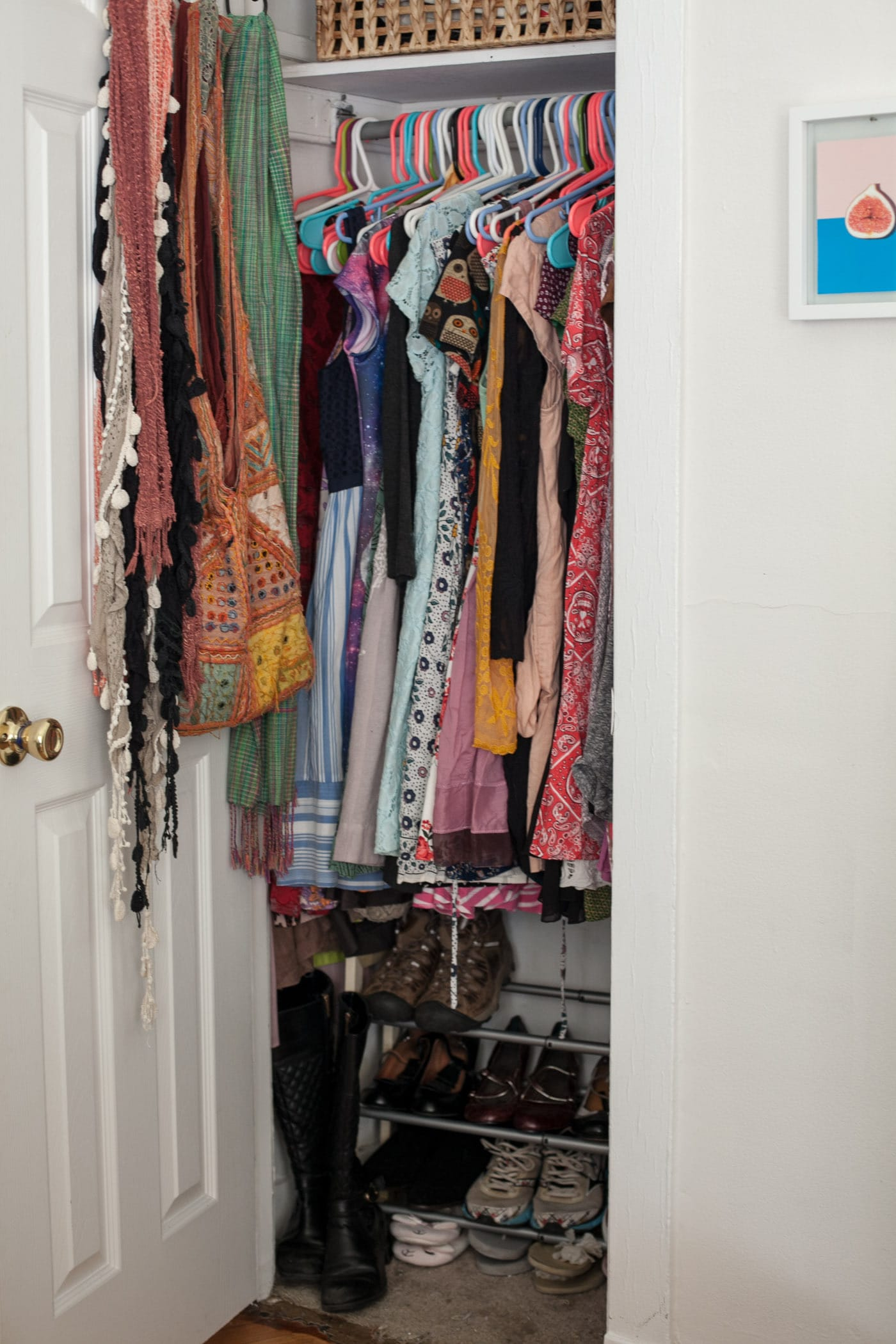 AFTER My bedroom closet has all of my shoes neatly organized, my dresses hanging, and a couple of scarves and bags. That's it!