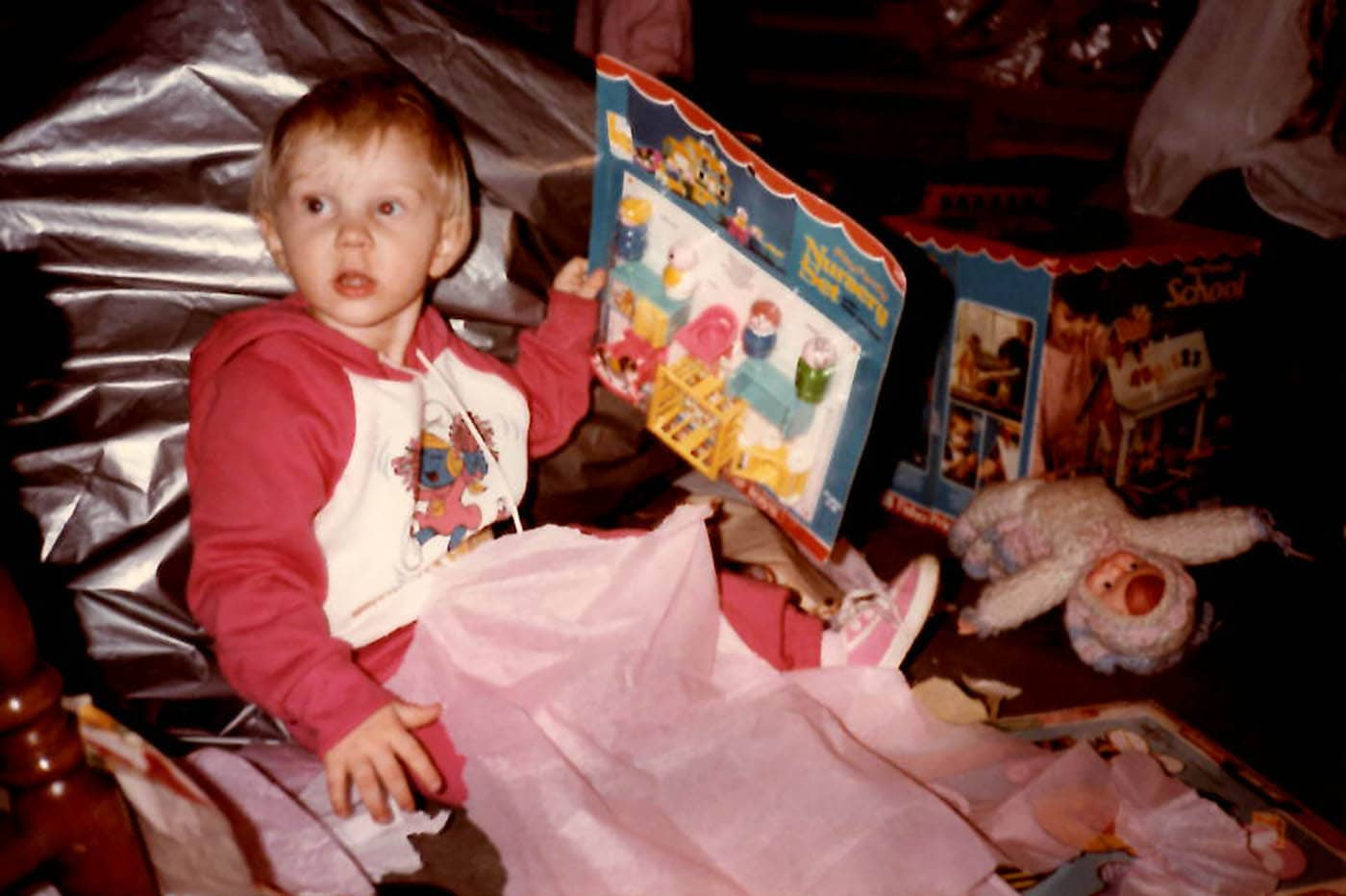Opening Christmas presents as a kid in the 80s.