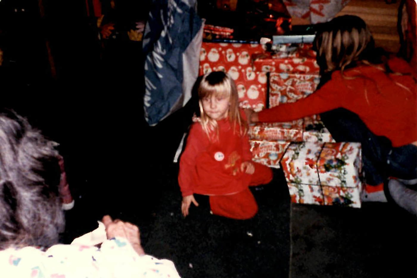 Val opening Christmas presents as a child of the 80s.
