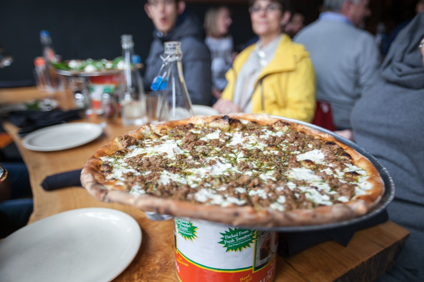 Pizza tour of Chicago with Chicago Pizza Tours - Pistachio ​Pesto ​pizza with pistachio ​pesto, ​berkshire ​sausage, ​burrata, and ​honey at Coalfire Pizza in Chicago