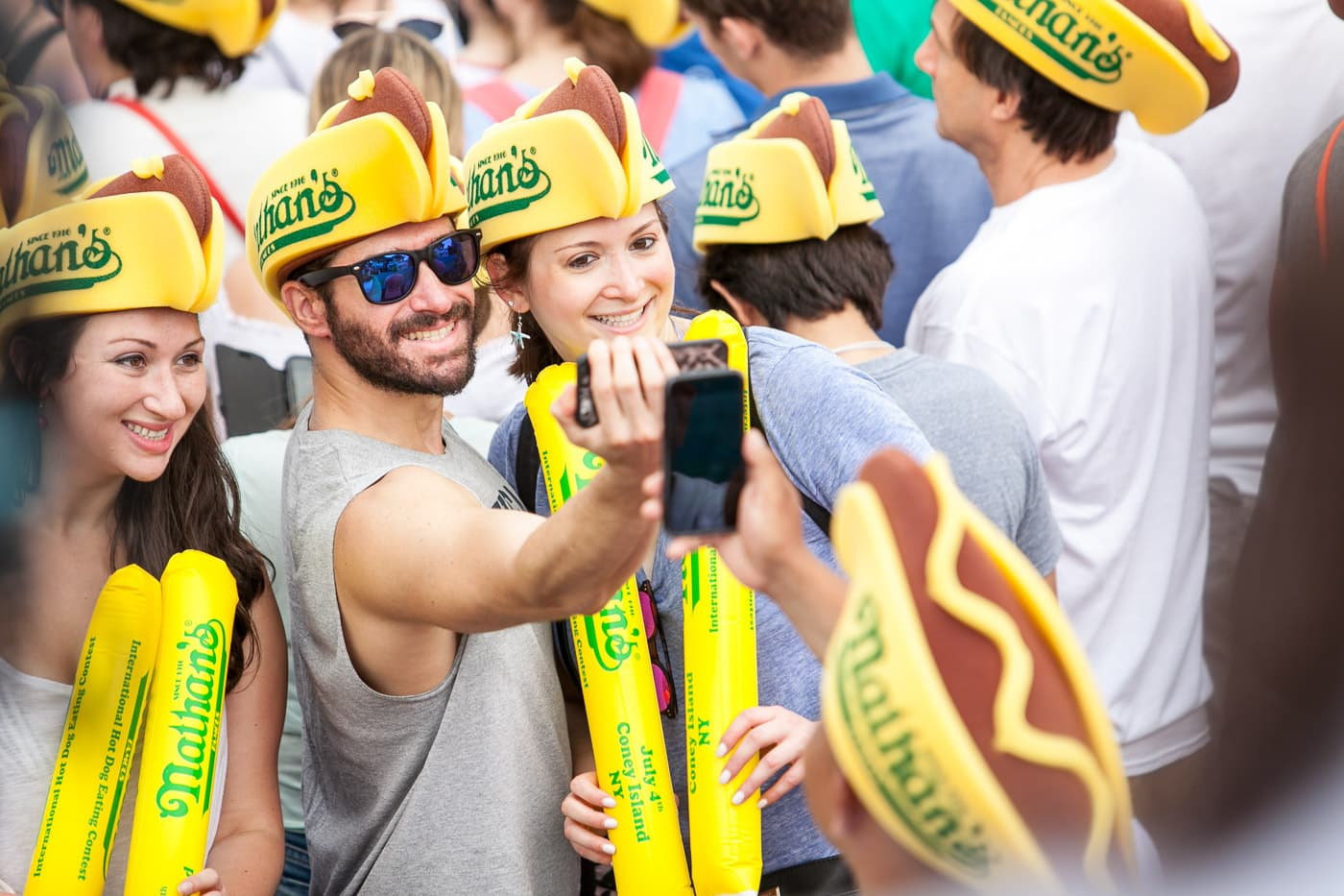 Fans cheer on the 2018 Nathan's Famous hot dog eating contest on the Fourth of July at Coney Island in Brooklyn, New York.