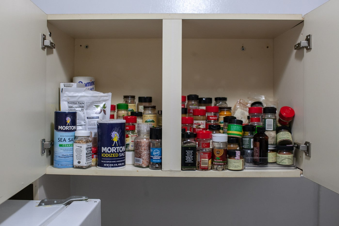 My apartment a year after KonMari. My spice rack before cleaning.