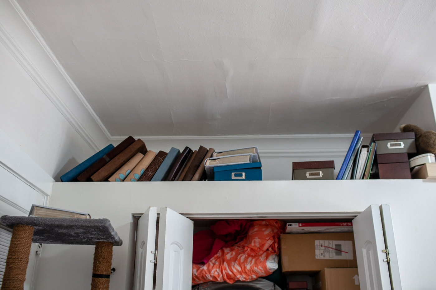 My apartment a year after KonMari. My living room closet shelf before cleaning.
