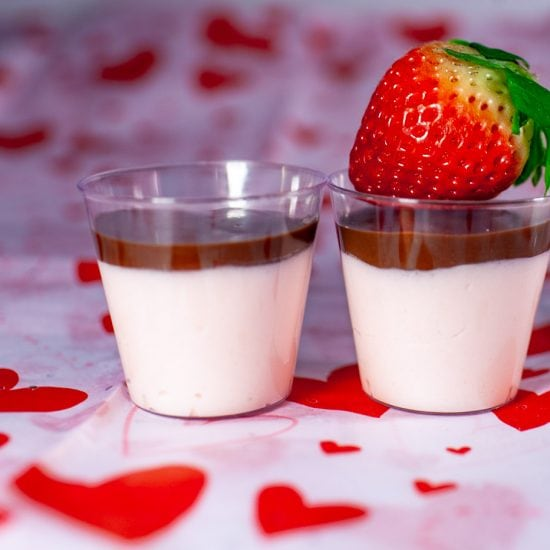 This recipe for chocolate covered strawberry pudding shots tops a layer of alcoholic strawberry pudding with a crisp chocolate shell to mimic the dessert.
