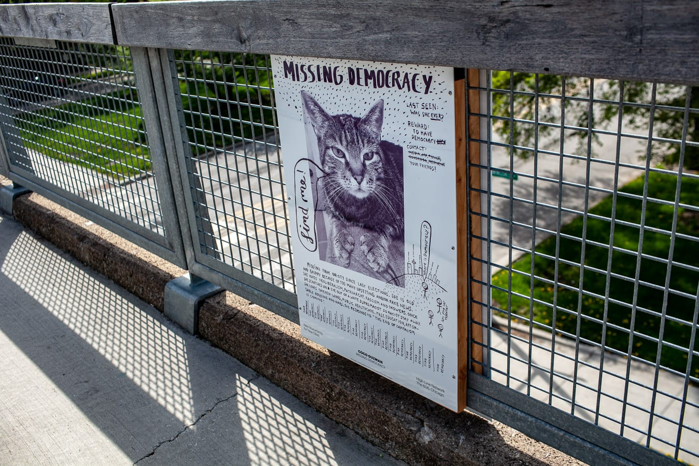 Missing Democracy cat poster - part of New Monuments for New Cities artwork on The 606 in Chicago. | Bloomingdale Trail | the 606 in early spring.