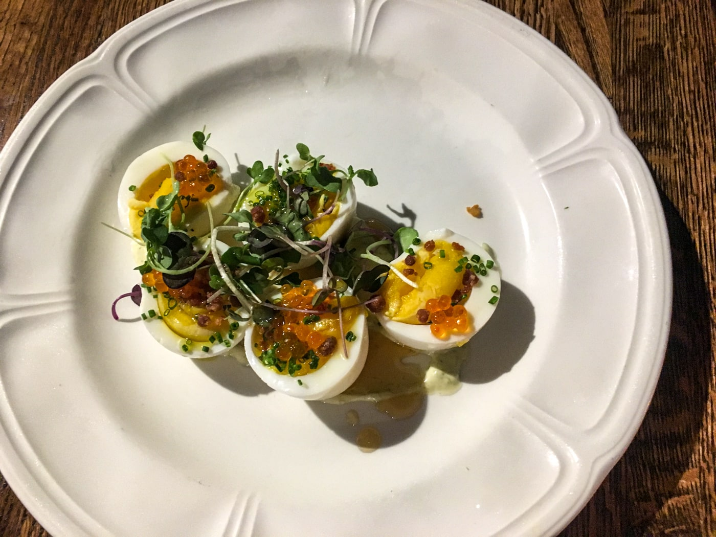 deviled farm eggs with ramp aioli, country ham, citrus infused maple, and smoked trout roe at Stirnella Bar & Kitchen in Omaha, Nebraska