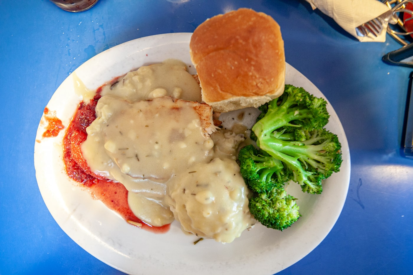 Roast Turkey Platter with cranberry applesauce, garlic butter broccoli, turkey gravy, and mashed potatoes at Monty's Blue Plate Diner in Madison, Wisconsin.