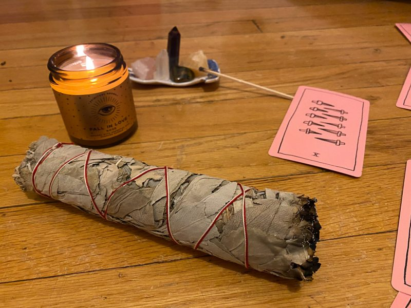 Smudge stick and tarot.