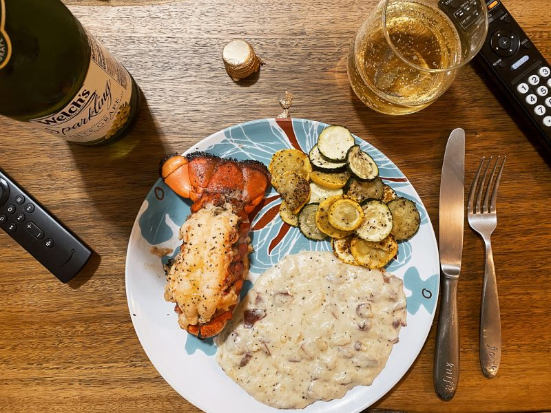 Lobster, mashed potatoes with way too much cream, zucchini, and a bottle of Welch's finest.