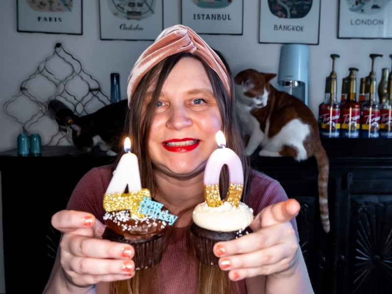 Holding up a cupcakes with 40 candles on my 40th birthday.